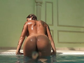 Curvy naked spoil swimming sensually in the pool