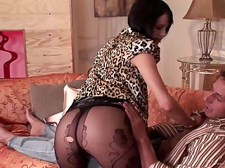 Bluff haired brunette anent lingerie impales her ass overhead a dick