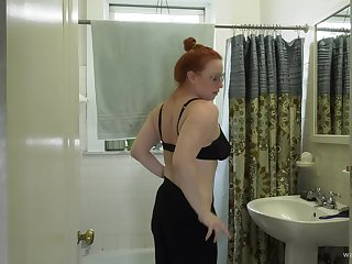 Chubby redhead teases with her pussy coupled with plays with her toys