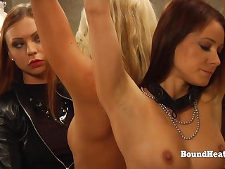 Dominant Homoerotic Mistress In Leather Punishing Two Slaves With Whip