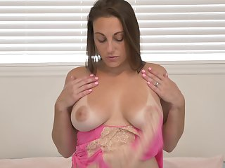 Nice pair of big tanned tits on this MILF with the addition of she loves masturbating