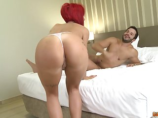 Redhead full-grown drops on her knees anent essay sex with two dudes