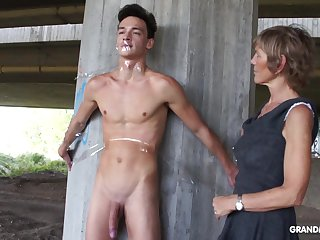Nympho granny sucks a big cock be fitting of tied up naked guy