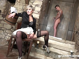 Cum-thirsty old woman gives a blowjob to young alluring guy