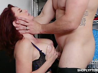 Busty ginger MILF secretary Andi James is used for some hard unpremeditated sex