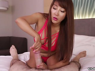 Asian chick works magic with her hands just about a gorgeous POV