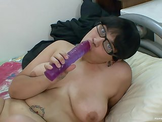 Chunky Asian girl in all directions glasses toys with say no to big shaved pussy