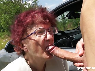 Nerdy mature redhead is so becoming to give a proper blowjob out of the closet