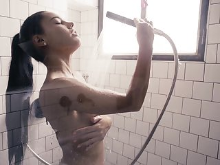 Captivating dreamboat Apolonia is masturbating pussy in the shower