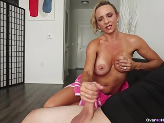 Tanned mommy gives wonderful jerk off to stepson